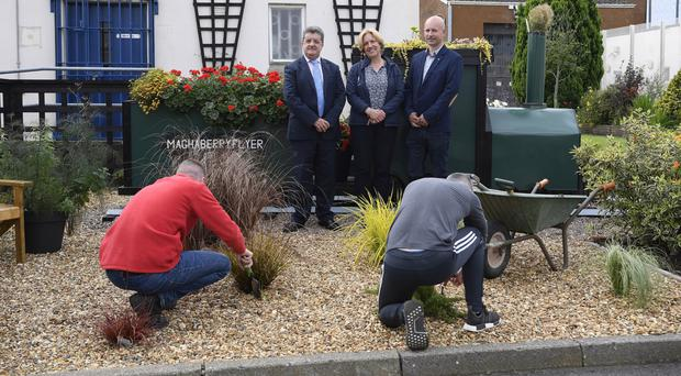 From left: Ronnie Armour, director general of the Northern Ireland Prison Service, Tammi Peek, National Trust volunteering and partnerships manager, and Richard Whiting, Belfast Met horticulture trainer at Maghaberry with prisoners
