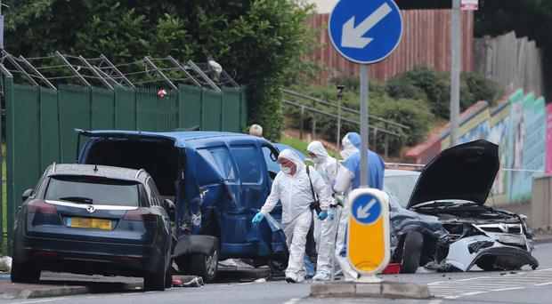 Forensics officers outside Belfast City Cemetery (Niall Carson/PA)