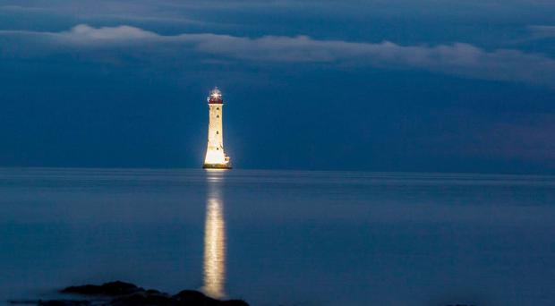 The Haulbowline Lighthouse has been illuminated (Carlingford Ferry)