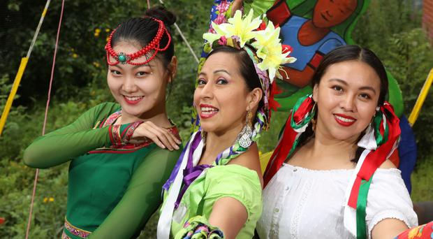 From left, Kancy Guan, classical Chinese dancer, and Mexican dancers Mayte Segura and Denise Navarrete at the launch of the Belfast Mela