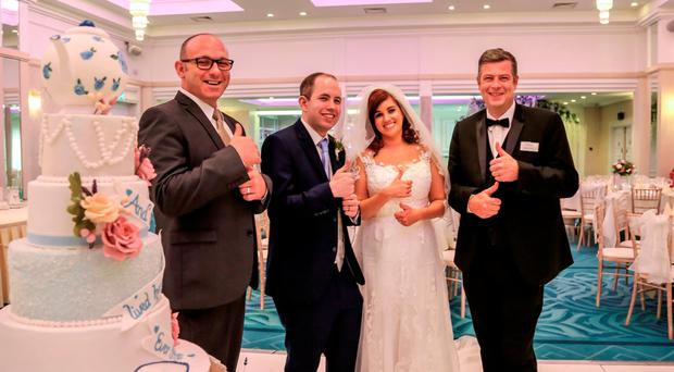 Couple Samantha Maher and Luke Davis with Roe Park Resort duty mangers Kevin Hunt (left) and Brian Lowney, who put their Hands That Talk sign language training into practice on the couple's wedding day