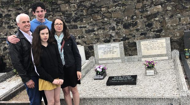 Bob Gilmour with his wife Kristen Hynes, and their children Declan and Sarah Gilmour at Ballymena cemetery (Family Handout/PA)