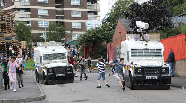 Police are attacked by youths at the site of a proposed bonfire in north Belfast (PA)