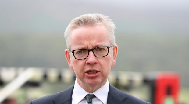 Chancellor of the Duchy of Lancaster Michael Gove during a visit to the town of Warrenpoint on the Irish border (Liam McBurney/PA)