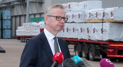 Michael Gove speaking to the media during his visit