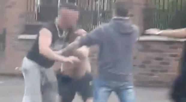Screen grabs showing a man being attacked during unrest in the New Lodge