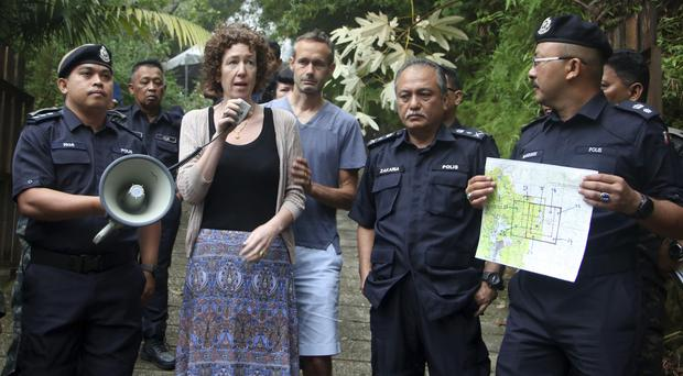 Meabh and Sebastien Quoirin speak to police in Seremban, Negeri Sembilan, Malaysia (The Royal Malaysia Police via AP)