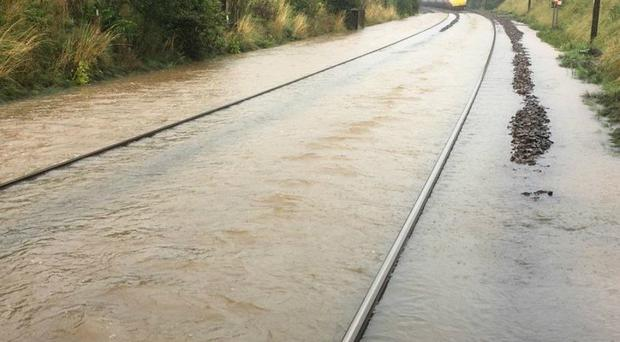 Flooding between Carlisle and Lockerbie (@NetworkRailSCOT/Twitter/PA)
