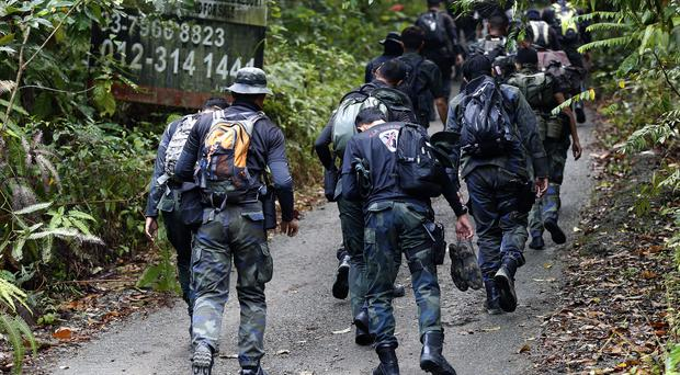 Members of a rescue team conduct a search and rescue operation for missing Nora Quoirin (AP Photo/FL Wong)