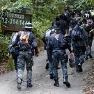 Searches in the forest in Seremban, Malaysia (FL Wong/AP))