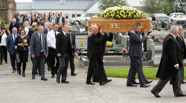 The coffin of Sylvia McKee is carried for burial at Seagoe Parish Church in Portadown after yesterday's funeral service
