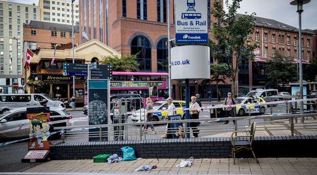 Police at the scene of a stabbing incident on Great Victoria Street in Belfast