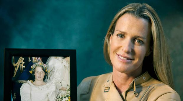 Lord Mountbatten's granddaughter India Hicks with a picture of herself at the wedding of Prince Charles and Lady Diana Spencer in 1981