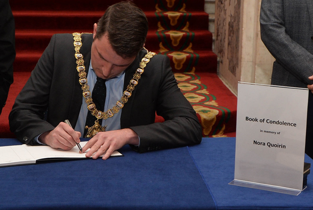 Lord Mayor of Belfast John Finucane signs a book of condolence for Nora Quoirin at Belfast City Hall