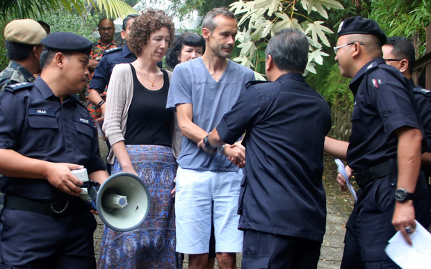 Nora Quoirin's parents Meabh and Sebastien shake hands with Malaysian police