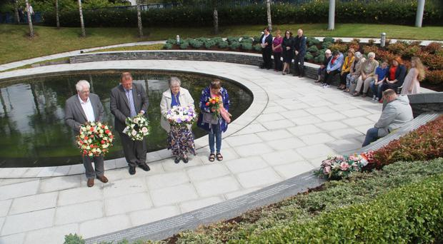 Relatives of the Omagh bomb victims lay wreaths at the town's memorial garden on the 21st anniversary of the atrocity