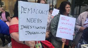Protesters take part in the rally in Enniskillen (Aoife Moore/PA)