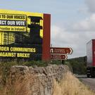 Anti-Brexit billboards on the northern side of the border between Newry in Northern Ireland and Dundalk in the Republic (Niall Carson/PA)