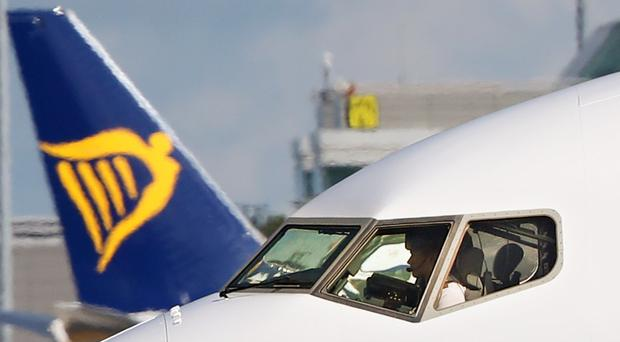 Ryanair claims strike action would be in breach of an agreement made in 2018 (Niall Carson/PA)