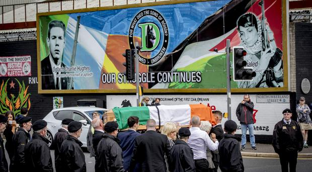 The coffin of Alex Murphy is carried along the Falls Road in west Belfast