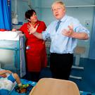 Prime Minister Boris Johnson meets with one-year-old patient Logan Rock during his visit to the Royal Cornwall Hospital yesterday