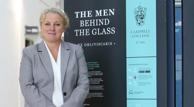 Cathy Law, development director at Campbell College, with The Men Behind the Glass exhibition at the Proni in Belfast