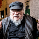George RR Martin speaks to Belfast Telegraph reporter Ralph Hewitt at Castle Ward in Strangford