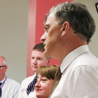 Julian Smith meets with staff and patients during a tour of Musgrave Park Hospital