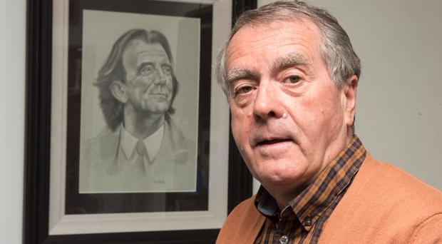 BBC Radio Foyle's Sean Coyle with a portrait of Gerry Anderson