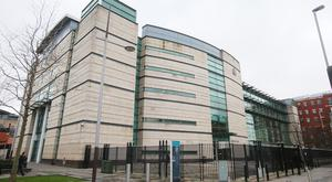 A man has appeared at Belfast Magistrates' Court charged with attempting to meet a child following child grooming (Niall Carson/PA)
