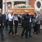 Mourners at the funeral of Pat Gillespie who died at the weekend