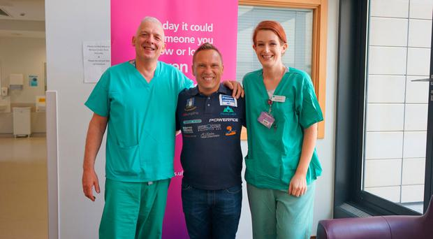 Attila Manyoki with staff at the Ulster Hospital Intensive Care Unit in Dundonald, Julia Bateman and David Tate (left)