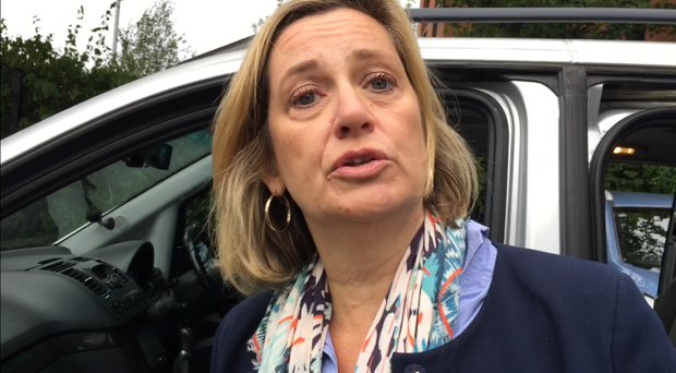 Amber Rudd outside a jobs and benefits office in east Belfast (David Young/PA)