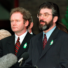 Sinn Fein's Gerry Adams and Martin McGuinness emerge from talks on the signing of the Good Friday Agreement