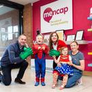 Getting ready for the Mencap NI Superhero Walk are (from left) Jim Maguire, business development manager from sponsors Belfast City Sightseeing, Harry Gilchrist (5), Grainne McKeating, Belfast City Sightseeing office manager, Isla Gilchrist (4) and mum Laura Gilchrist from Downpatrick