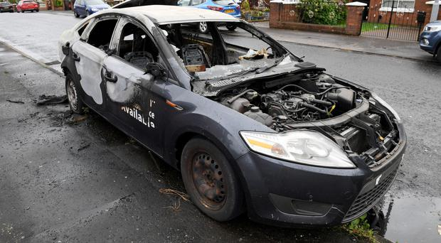 The burnt out taxi on Rosapenna Street