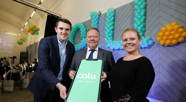 The Colu team at an event for city merchants. From left, Chris Bunce, Belfast community sales manager, Richard Cherry, general manager, Colu UK and Leona Mills, Belfast community marketing manager (Colu/PA)
