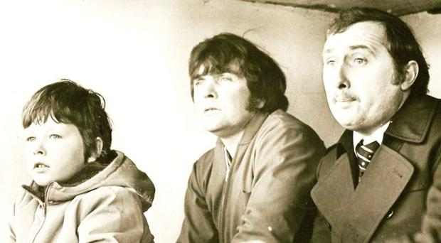 A young John Hutton (left) in the Cliftonville dugout with his father, Jackie (right), and Jackie Patterson