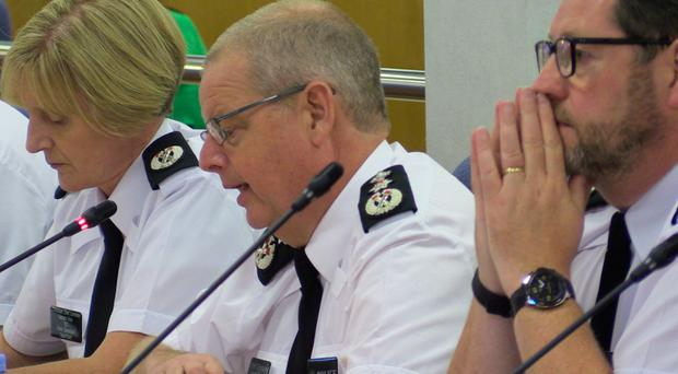 PSNI Chief Constable Simon Byrne (centre) speaking at the Northern Ireland Policing Board in Belfast yesterday