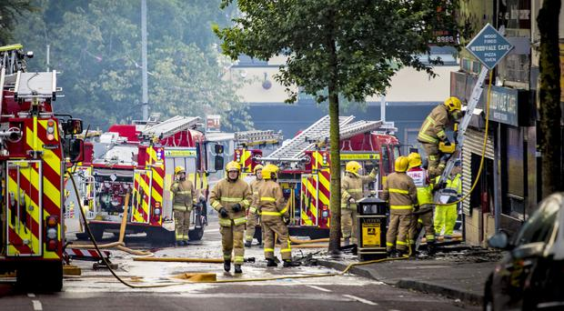 Firefighters deal with a blaze on the Woodvale Road in Belfast yesterday