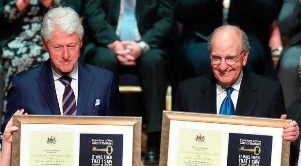 Bill Clinton and George Mitchell receiving their Freedom of Belfast awards in 2018
