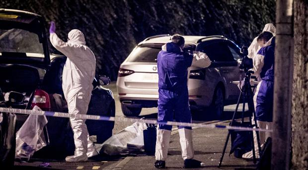 Forensics officers at the scene in Strabane where an explosive device was found