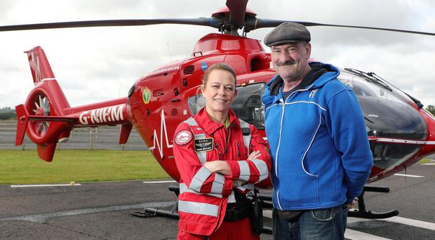 Recovering patient Sam Graham with HEMS Paramedic Emma Boylan