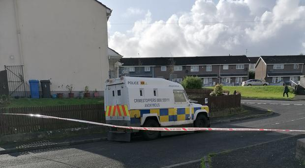 Police in Creggan Heights, Londonderry, after residents were evacuated when a suspicious device was found in a house (Aoife Moore/PA)