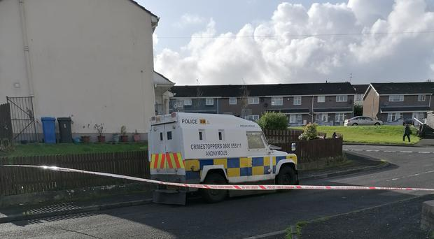 Police at the scene in Creggan Heights, Londonderry, after residents were evacuated when a suspicious device was found in a house (Aoife Moore/PA)