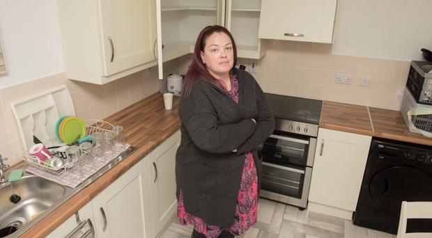 Sinead Quinn in the kitchen of her new home at Derrymore, which she is unable to use due to plaster mites