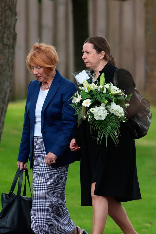 Mourners arrive for Nora Quoirin's funeral service at St Brigid's Church, south Belfast