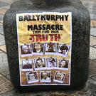 A poster featuring photos of those killed in the Ballymurphy shootings (PA)