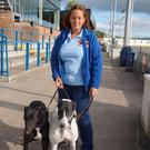 Tara Fitzpatrick with two retired greyhounds