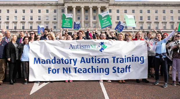 Autism NI supporters and MLAs at Stormont yesterday